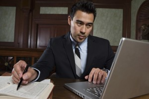 A Social Security Disability advocate working on a case for a client
