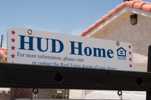House with a HUD sign on it that is being sold through the Housing and Urban Development office of the U.S. Government