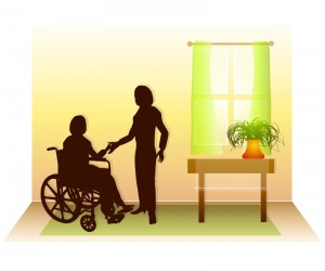 Person in wheelchair who is receiving assistance from a home helper