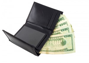 Wallet with money coming out from increased Social Security benefits obtained through a lawyer