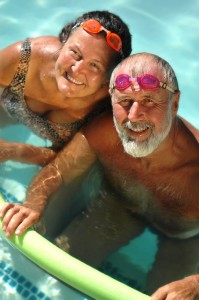 Senior citizen couple in the swimming pool at an active adult community