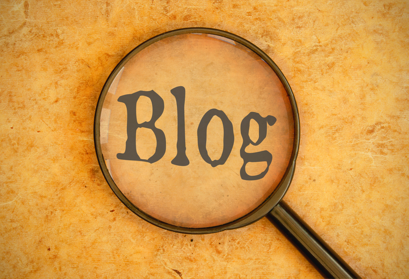Blog with Magnifying glass