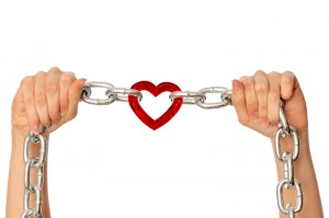 Chain with links together bound by a heart