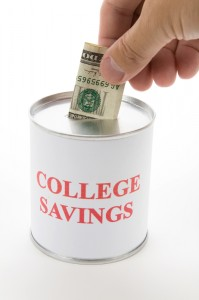 Can with a dollar being placed in it for college savings