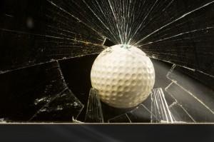 Golf ball going into broken window