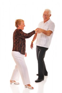 Older couple dancing the jitterbug which is a dance style from the 1940's