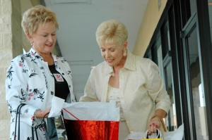 Two female new friends who are opening a gift