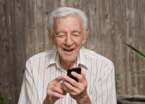 Laughing man using a smart phone