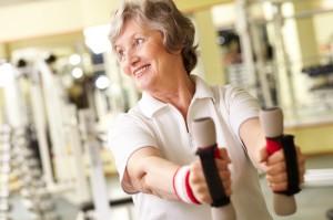 Elderly woman doing some aerobic exercises