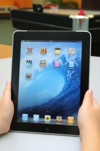 Woman holding an Apple iPad Air