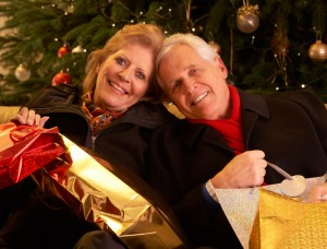 Older parents with Christmas gifts for their grown children