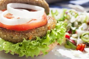 Veggie Burger with lettuce, tomato, onion and a side of bean salad