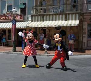 Mickey and Minnie Mouse dancing down Main Street at Disneyland California