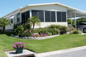 Nice mobile home with flowers in front