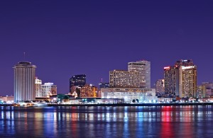 Picture of New Orleans at night with the Mississippi River in the foreground