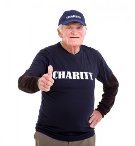 "Senior citizen with the word ""charity"" on his black shirt"