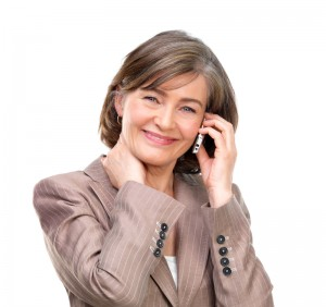 Woman wearing a brown dress suit using a cell phone