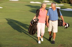 Happy couple spending the afternoon golfing