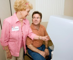 Female senior citizen volunteer helping at a poll booth