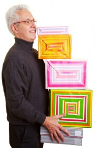 Newly retired man carrying the many gifts given to him for this special retirement party